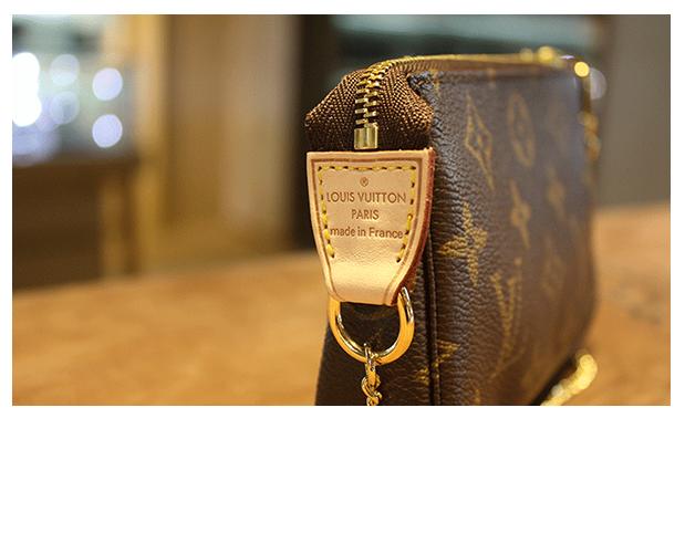路易威登(lv)女士手拿包小零钱包 经典老花 M58009 褐色